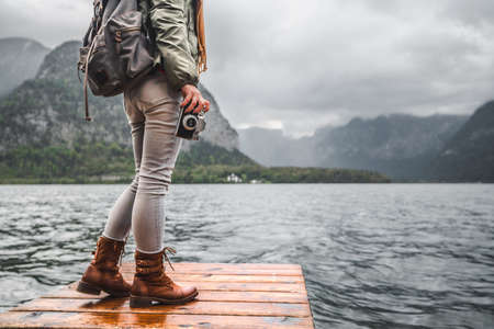 Photographer with a retro camera on the background of the Austrian lake