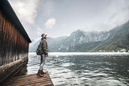 Young girl with a backpack by the lake in Austria Stock Photo
