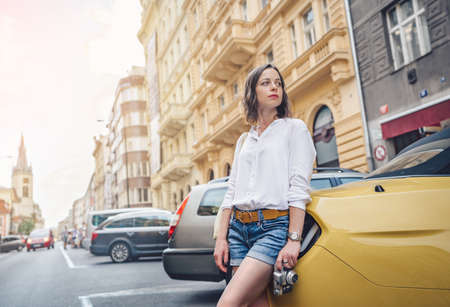 Young attractive woman with a retro camera in Europe Stock Photo