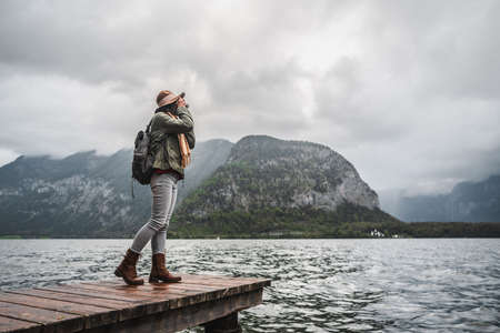 Young photographer with a retro camera by the Austrian lake Stock Photo