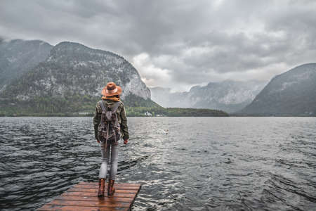 Young traveler by the lake outdoors