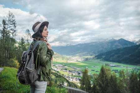 Young attractive tourist with a backpack in Austria Stock Photo