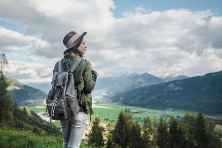 Young attractive woman with a backpack in Austria Stock Photo