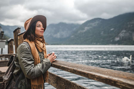 Beautiful girl with a retro camera in Hallstatt