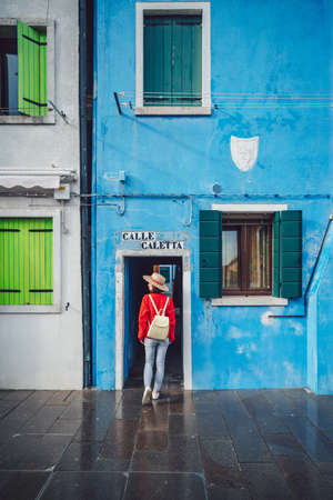 Young girl with a backpack in Burano