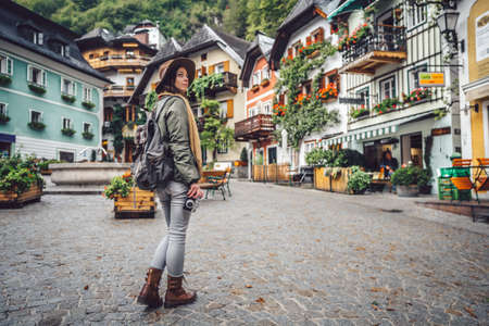 Beautiful girl with a retro camera in an alpine village