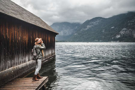 Young photographer at the alpine lake Stock Photo