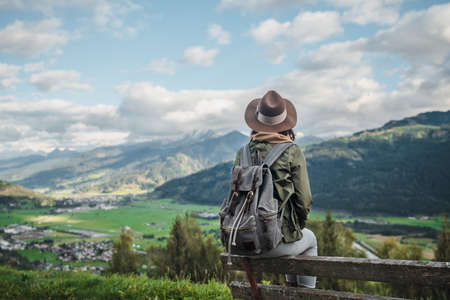 Young woman with a backpack in the Alpine mountains