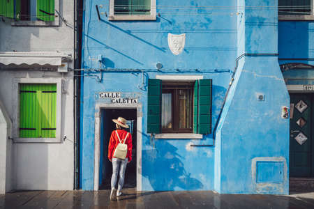 Young attractive girl in Burano, Italy