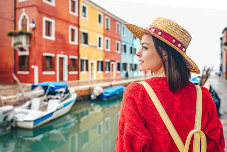 Beautiful girl in a straw hat in Italy Stock Photo