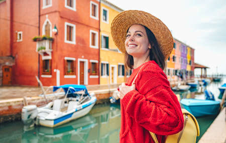 Smiling beautiful girl in a straw hat in Italy