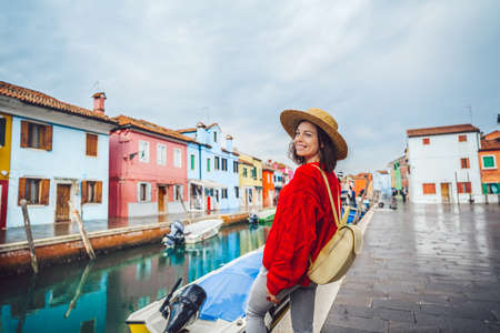 Smiling young tourist traveling in Italy