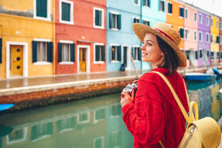 Beautiful girl with a retro camera in Italy