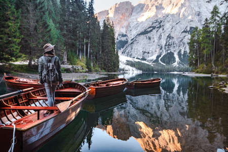 Young hiker with a retro camera in a boat