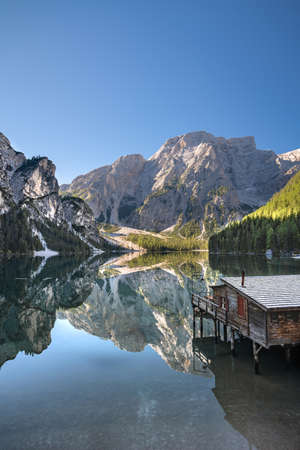 Hut at the italian lake Braies in autumn Stock Photo
