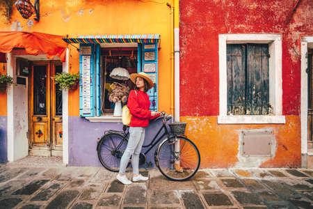 Attractive girl with a bike in Burano