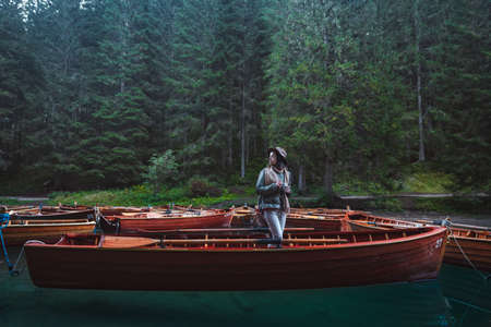 Young photographer with a retro camera in a boat Stock Photo
