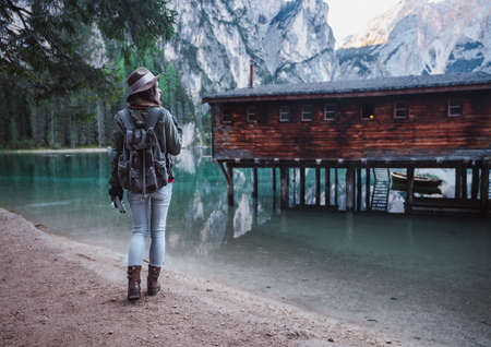 Young girl with a retro camera at the Lake Braies