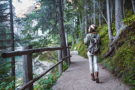 Young girl with a backpack in the forest