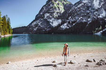 Young photographer with a camera at Lake Braies
