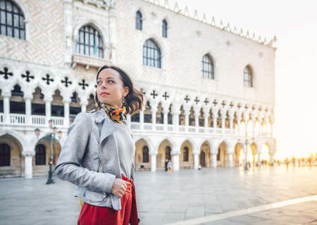 Attractive young girl on the square in Venice