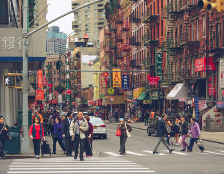 A crowd of people in Chinatown in New York City
