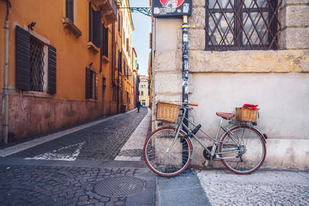 Bicycle with a basket on the street in Verona