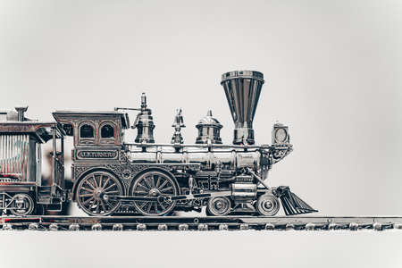 Silver steam train on a white background