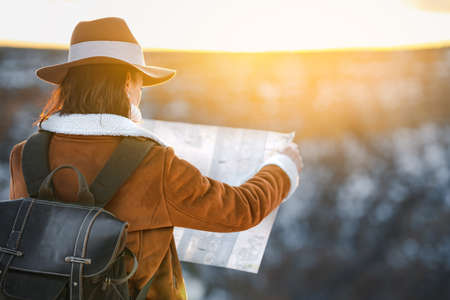 Young woman with a map in the National Park Grand Canyon