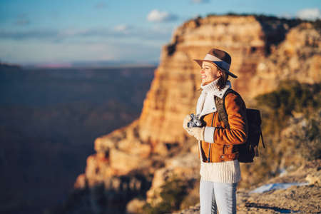 Young hiker with a retro camera in the Grand Canyon National Park