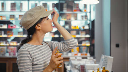 Young girl in a beauty store in Paris, France