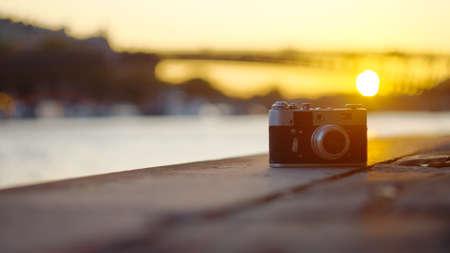 Retro camera at sunset, close-up Reklamní fotografie