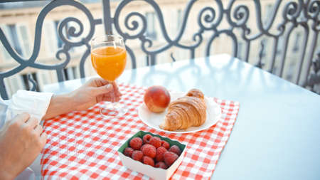 French breakfast on the balcony in Paris Фото со стока