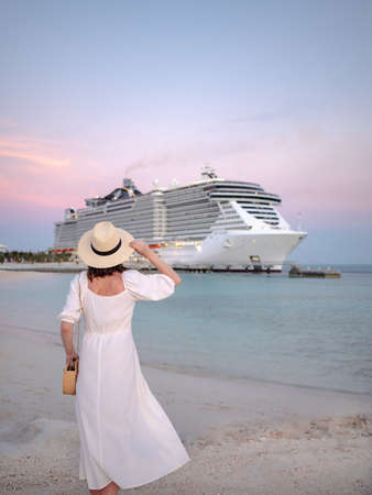 Young traveler by the cruise ship at sunset