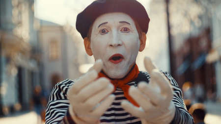 The face of a mime on the street, close-up