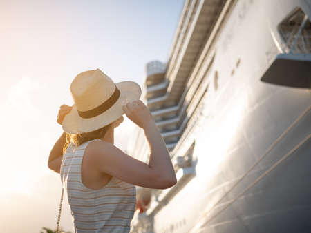 Young traveler by the cruise ship in the sun