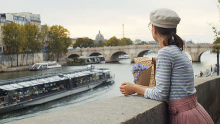 Young girl on a bridge in Paris, France