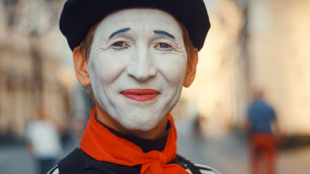 Smiling face of a mime on the street, close-up
