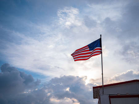 American flag against the sky outdoors