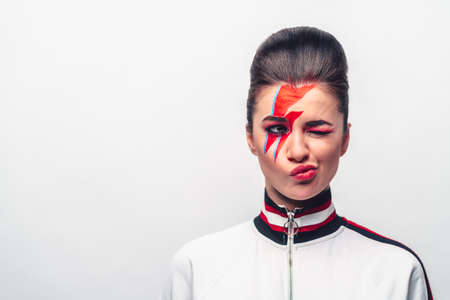 Emotional young woman with art make-up