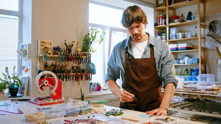 Working mature man in uniform in studio