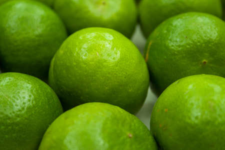 Closed-up of a bunch of lime on a white plate photo
