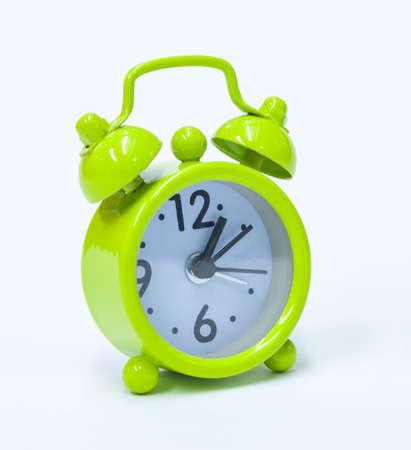 oclock: Small cute green isolated old-fashion alarm clock