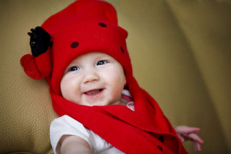 Smiling infant baby girl in the lady bug hat Stock Photo - 8898818