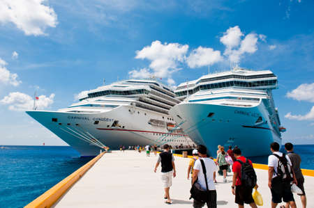 Two tourist cruise liners in the port of Mexico and tourists walking to them with the luggage to have theis vacation