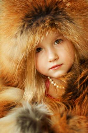 Charming girl in fox furs
