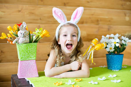 bunny ears: Happy girl in fancy bunny ears celebrating easter in country house