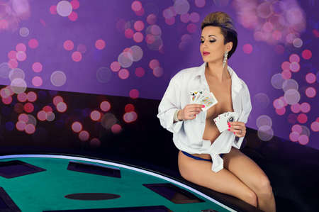 Erotic sexy passion young woman in lingerie model ready to play poker cards in casino Stock fotó