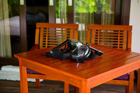 Full moon masks on the table ready for snorkeling Stock Photo