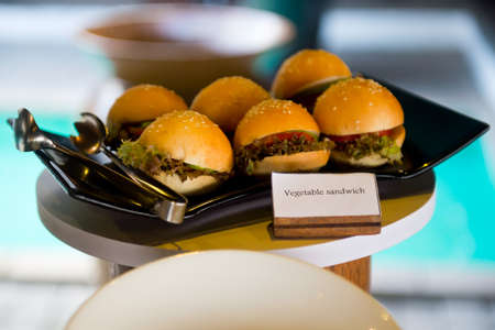 Delicious hotel restaurant allinclusive buffet with tasty food. Vegan burgers and sandwiches